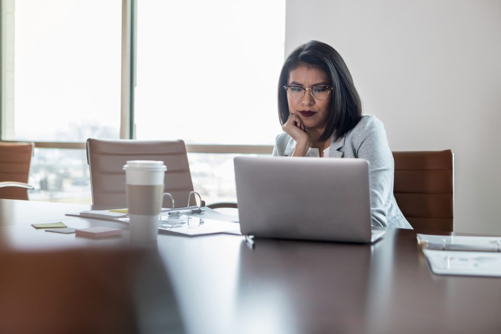 After looking at the last month's sales report, a mid adult Hispanic small business owner is concerned about cash flow.