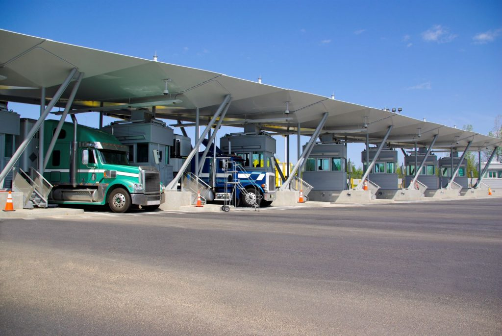Semi-trucks passing through border